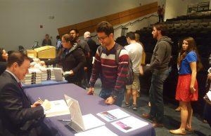 "Author Andrew Solomon signs copies of his book, ""Far and Away: Reporting from the Brink of Change."""