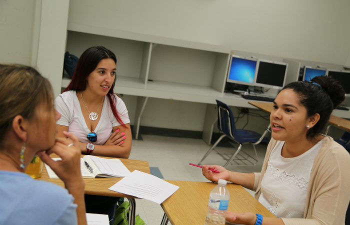 "Students in assistant professor Maria Lovett's Teaching Diverse Populations class discuss so-called ""Gangster Gardener"" Ron Finley's TED Talk which was shown by students in The Algebra Project's Summer Institute at Miami Northwestern Senior High School."