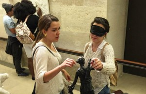 Students participating in the Recreational Therapy study abroad course this summer took turns guiding each other through the Louvre museum while blindfolded to simulate blindness. Here they get a chance to interact with reproductions of famous sculptures on display in the museum.