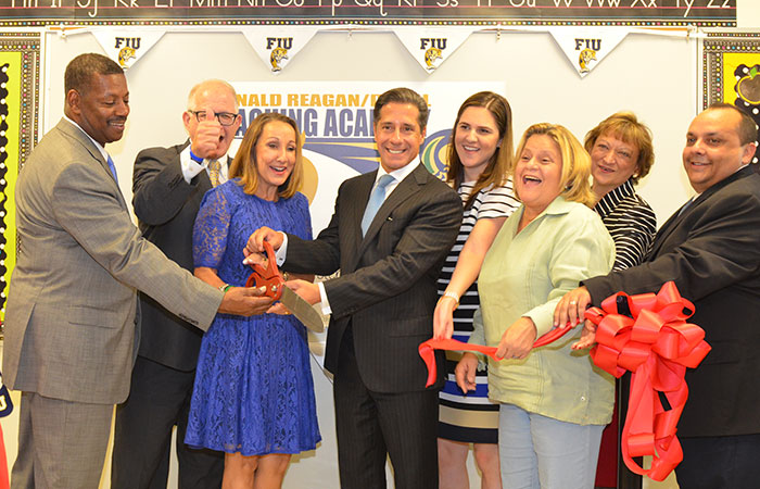 MDCPS Regional Superintendent Albert Payne, Jr., FIU President Mark B. Rosenberg, MDCPS School Board Member Susie V. Castillo, MDCPS Superintendent Alberto Carvalho, U.S. Rep Ileana Ros-Lehtinen, College of Education Dean Delia C. Garcia and Ronald Reagan / Doral Sr. High Principal Juan Carlos Silva cut the ribbon opening the new Teaching Academy at Ronald Reagan/Doral Senior High.