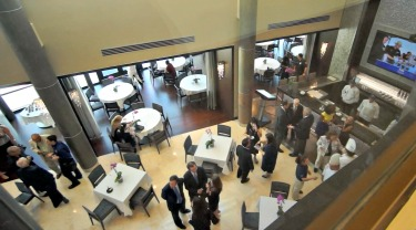 Guests at the new 140-seat restaurant management lab's ribbon-cutting ceremony mingle inside the facility.