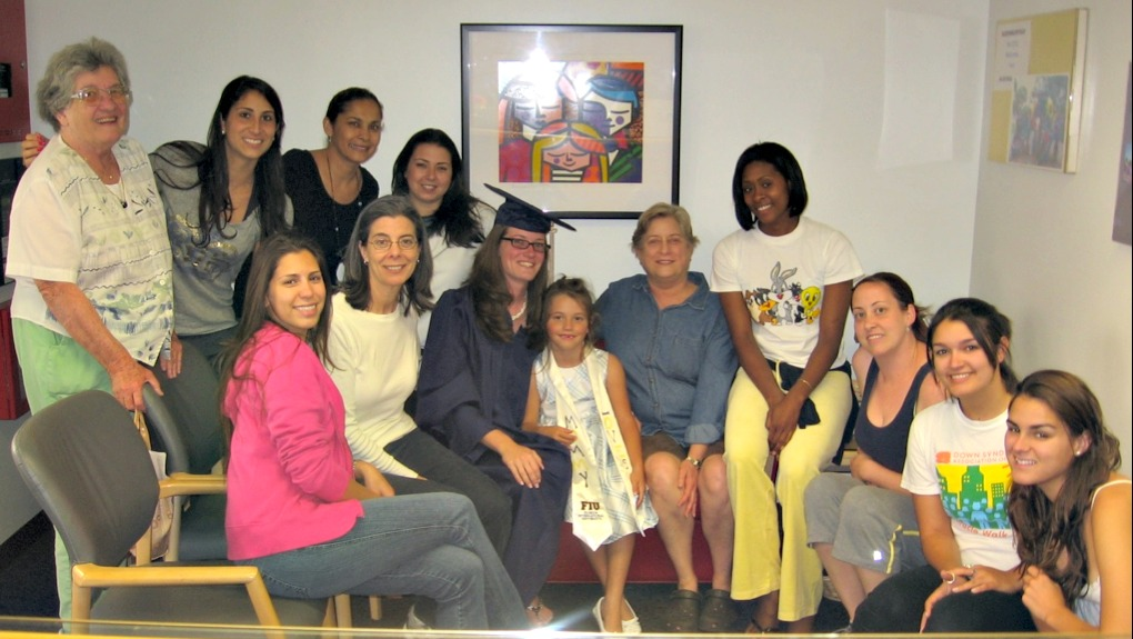 Tiffani Tallon (center) with daughter Alexis, pose with Children's Creative Learning Center staff after graduation in 2009.