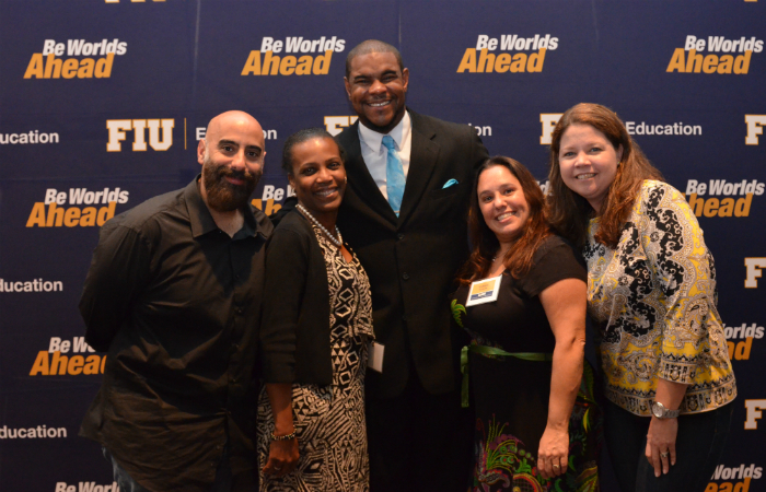 Paul V. Wilson (center) poses for a picture with members of his Urban Education cohort.