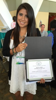 Valeria Paz accepts the Ecological Society of America's Strategies for Ecology Education, Diversity and Sustainability Chapter of the Year award in August.