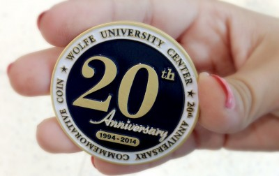 A commemorative coin for the 20-year anniversary of the Wolfe University Center was given to guests as an historic keepsake.