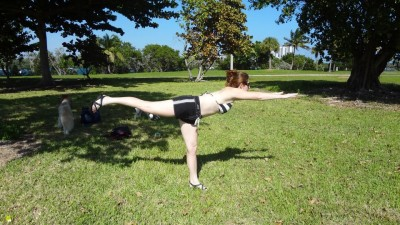 Podcameni demonstrates Warrior 3 Pose