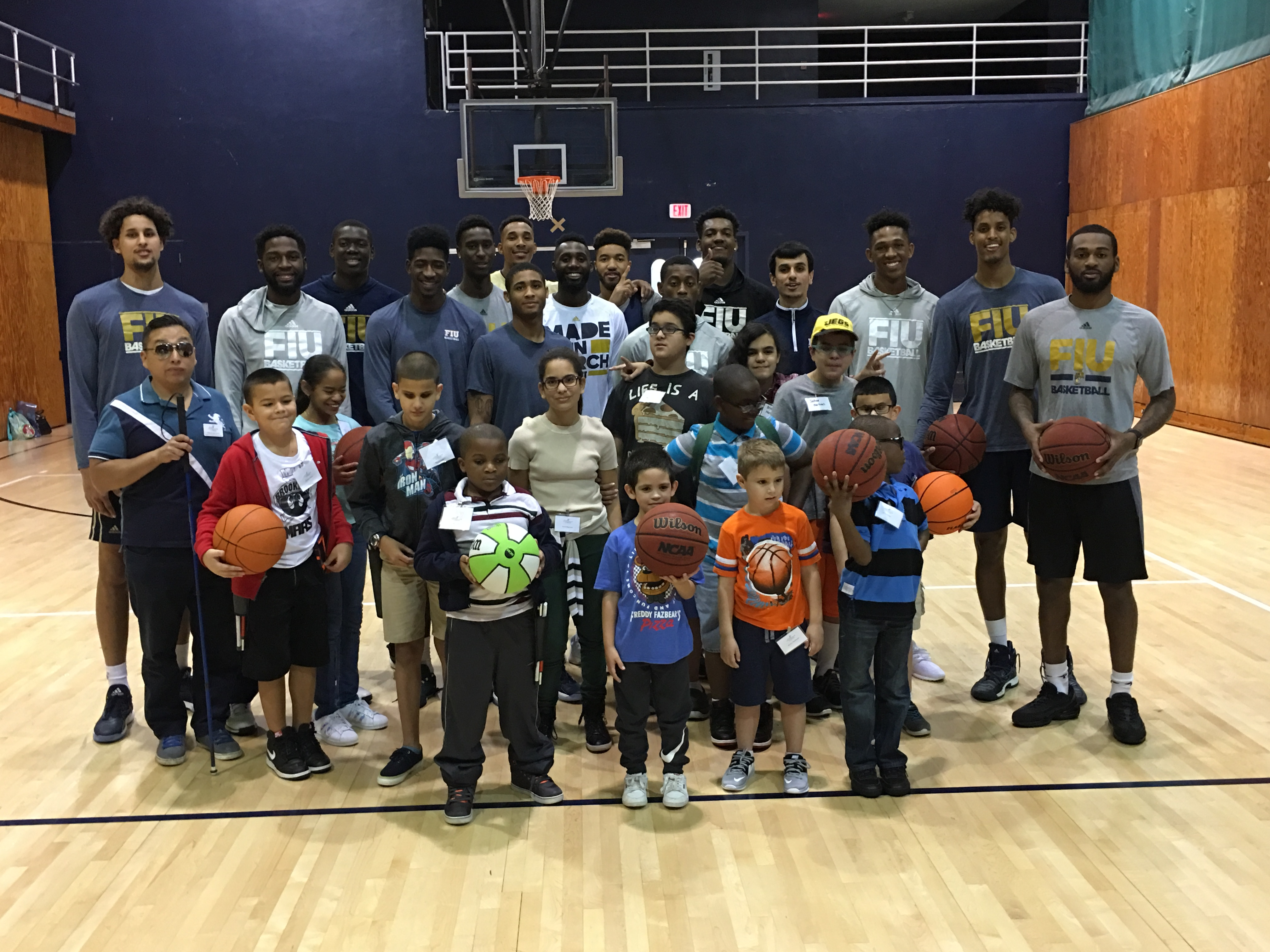 The FIU men's basketball team hosted children from Lighthouse for the Blind at FIU Arena on Jan. 5.