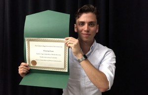 Jonathan Bursztyn holds his award at the first-ever #PantherCage, hosted by the FIU School of Journalism and Mass Communication, at the FIU Biscayne Bay Campus on March 26, 2015.
