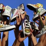 FIU students paint sneakers for Haiti's children