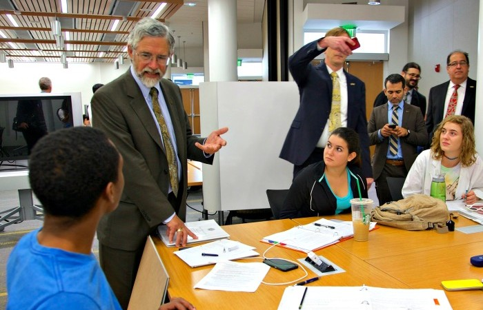 White House chief science adviser John P. Holdren (left) speaks with students at FIU during a visit on Oct. 1.