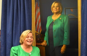 Rep. Ros-Lehtinen cheerfully poses next to her newly unveiled Foreign Affairs Chairman portait