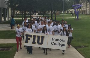 Students take part in early voting march to the polls
