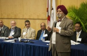 Jag Khalsa (forefront), chief, Medical Consequences Branch, Division of Pharmacotherapies and Medical Consequences in the NIH, leads a panel discussion at the First Personalized Nanomedicine Symposium on Feb. 18.   Seated, from left: Sahkrat Khisroev, FIU, Kendall Bryant, NIH, Christopher Weis, NIH, Mahendra Kumar, University of Miami, and Jaymohan Joseph, NIH.