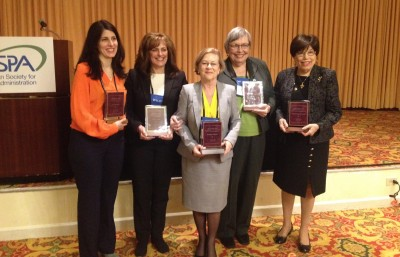 Meredith Newman, third from left, receives the Joan Fiss Bishop Leadership Award from the Section for Women in Public Administration during its annual awards breakfast.