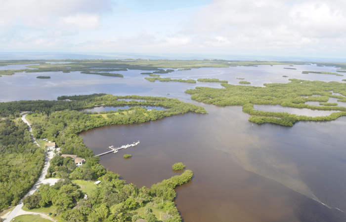An aerial view of the Rookery Bay field station dock in Rookery Bay National Estuarine Research Reserve
