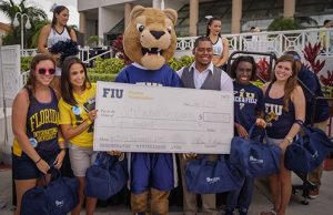 Alumni pay it forward by helping students with scholarship dollars