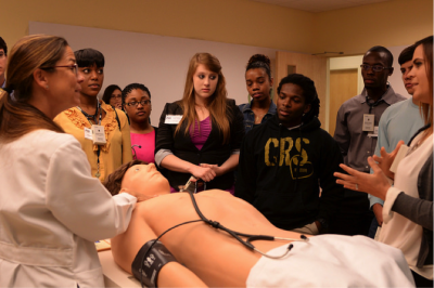 "Vivian Obeso, M.D. introduces the ""Doctors of Tomorrow"" to Harvey in the simulation lab."