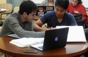Luis Avila (left) works with Math Department tutor David Lardizabal (right) at the CfAS.