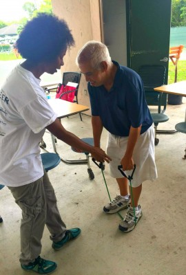 FIU student intern, Wendy McQueen, helps Special Olympics Florida Healthy Community program participant.